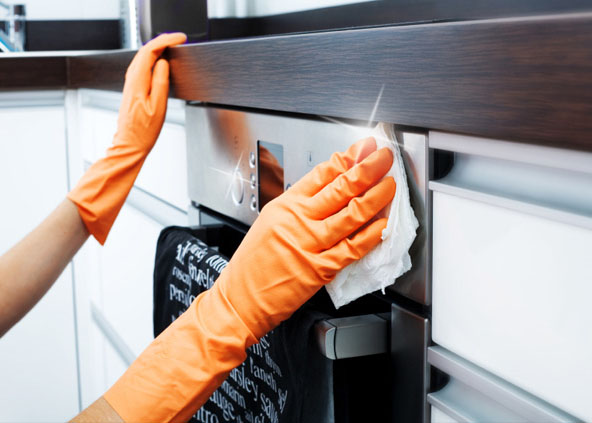Hands providing end of lease cleaning in Canberra